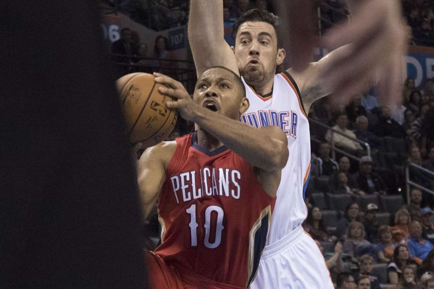 Nick Collison #4 of the Oklahoma City Thunder fails to block Eric Gordon #10 of the New Orleans Pelicans.