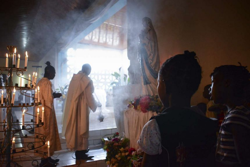 Worshippers attend a Sunday mass at Saint Sauveur Catholic church, adjacent to the IDP camp that Pope Francis is scheduled to visit.