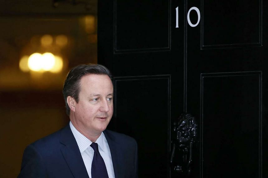 Britain's Prime Minister David Cameron stands outside Number 10 Downing Street in London.
