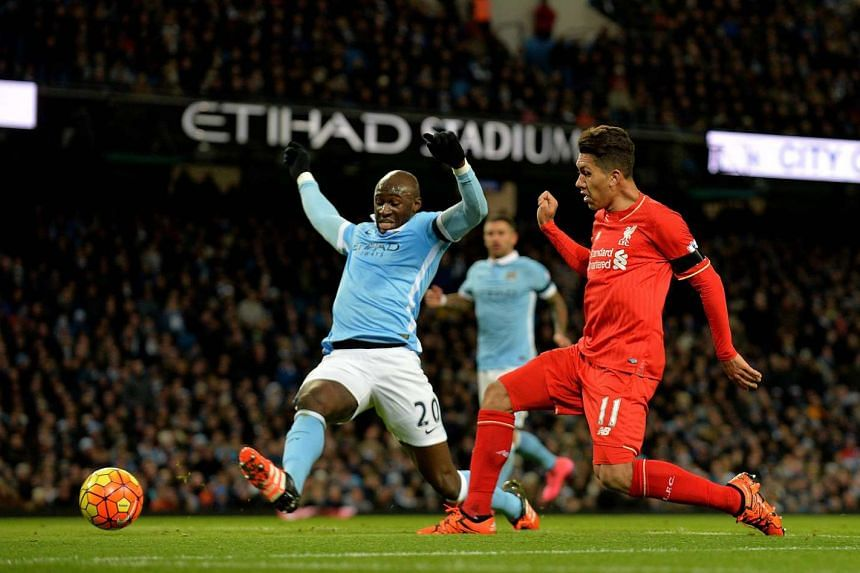 Liverpool's Roberto Firmino scoring to make it 3-0 in the 33rd minute against Manchester City.