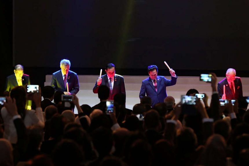 Asean leaders including (from left) Philippine President Benigno Aquino, Singapore PM Lee Hsien Loong, Thai Prime Minister Prayut Chan-o-cha, Vietnamese Prime Minister Nguyen Tan Dung and Malaysian Prime Minister Najib Razak striking drums at a cerem