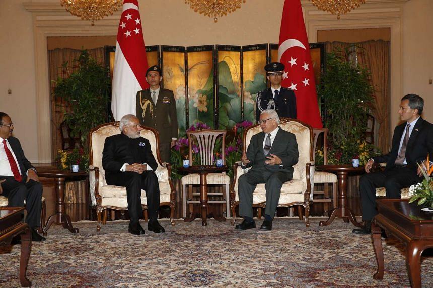 Indian Prime Minister Narendra Modi (centre, left) meeting President Tony Tan Keng Yam (centre, right) on Tuesday (Nov 24).