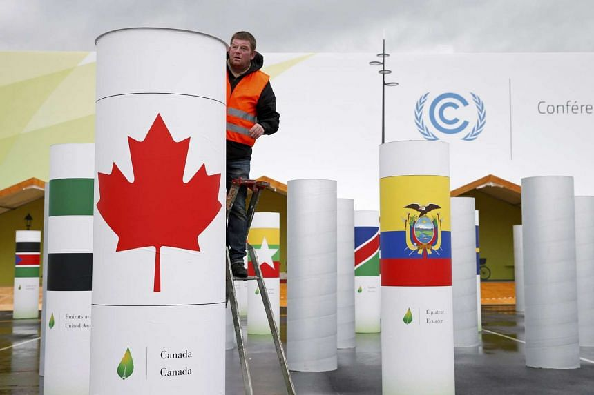A man works on the site of the upcoming COP21 World Climate Summit in Le Bourget, France on Nov 19, 2015.