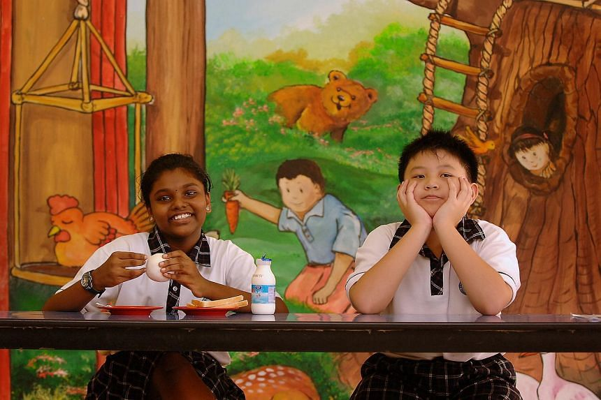Bukit View Primary students (from left) Yao Wenqi and R.Rajeshree love their breakfasts, having bread and a glass of milk daily.