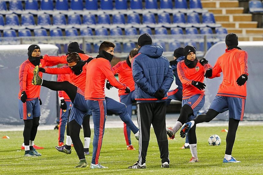 Valencia players warm up during their team's training session at the Petrovsky stadium in St. Petersburg, Russia, on Nov 23, 2015.