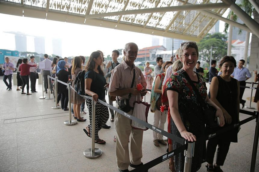 Visitors queuing up at the refurbished National Gallery Singapore, which opened its doors to the public today (Nov 24).