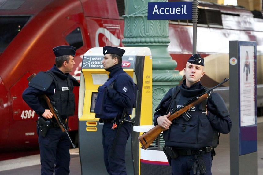 Policemen patrolling Paris' Gare du Nord train station near a Thalys train on Nov 14.
