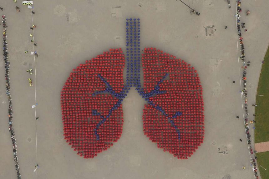 Participants forming a human lung during a Guinness World Record attempt in Beijing.