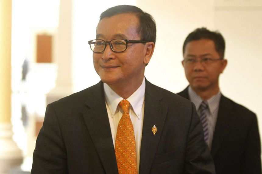 Cambodia has been plunged into a bitter political crisis after an arrest warrant was issued for Sam Rainsy.