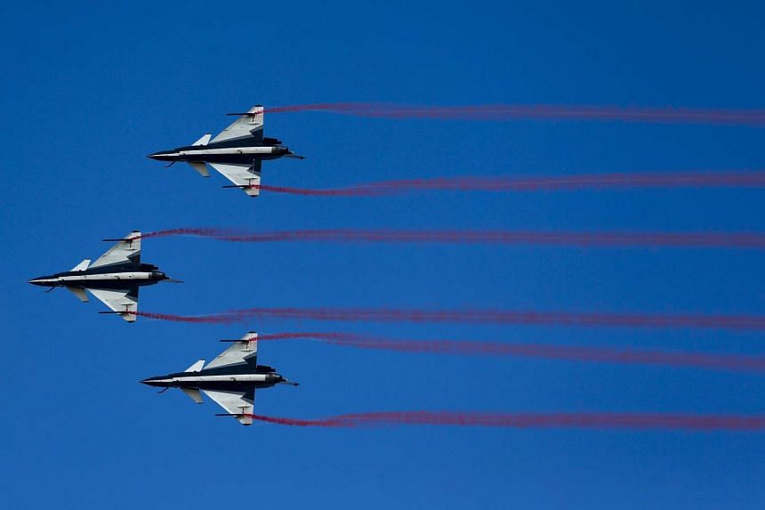 China's J-10 fighter jets perform during a media demonstration at the Korat Royal Thai Air Force Base.
