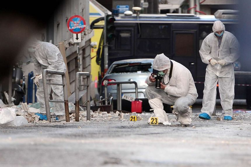 Police forensic experts searching for evidence outside the offices.