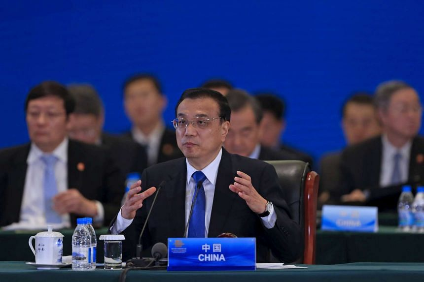 Chinese Premier Li Keqiang speaking at a summit in Suzhou.