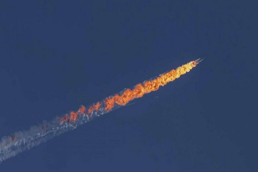 The Russian plane in flames over north Syria.