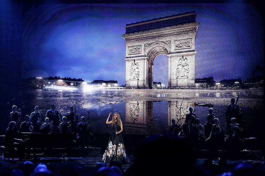 Celine Dion performs Edith Piaf's classic Hymne A L'Amour (Hymn To Love) in honour of the victims of the Paris attacks at the 2015 American Music Awards in Los Angeles.
