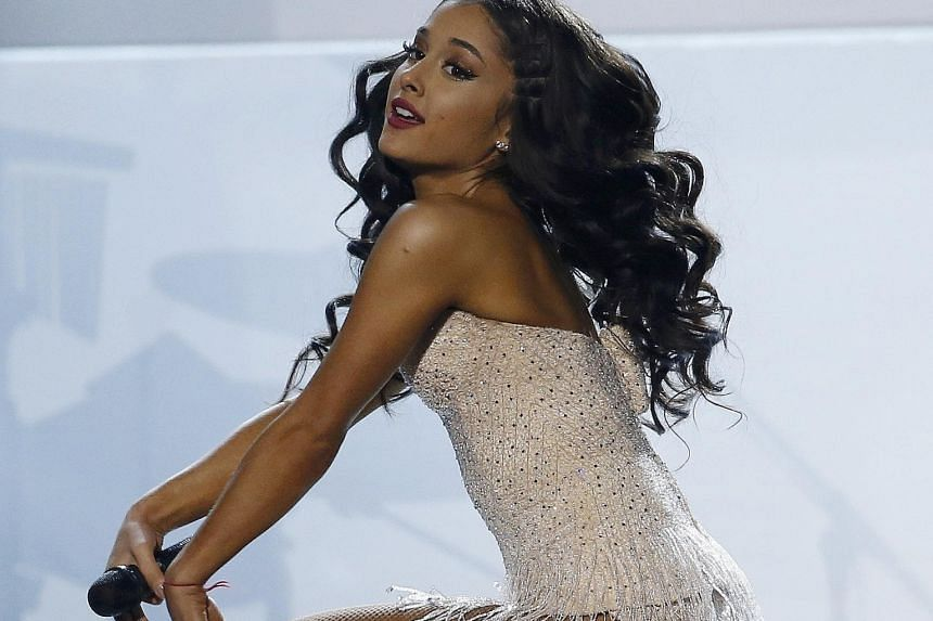 Ariana Grande (above) performs at the event, where she beat Taylor Swift for Favourite Female Pop or Rock Artist.