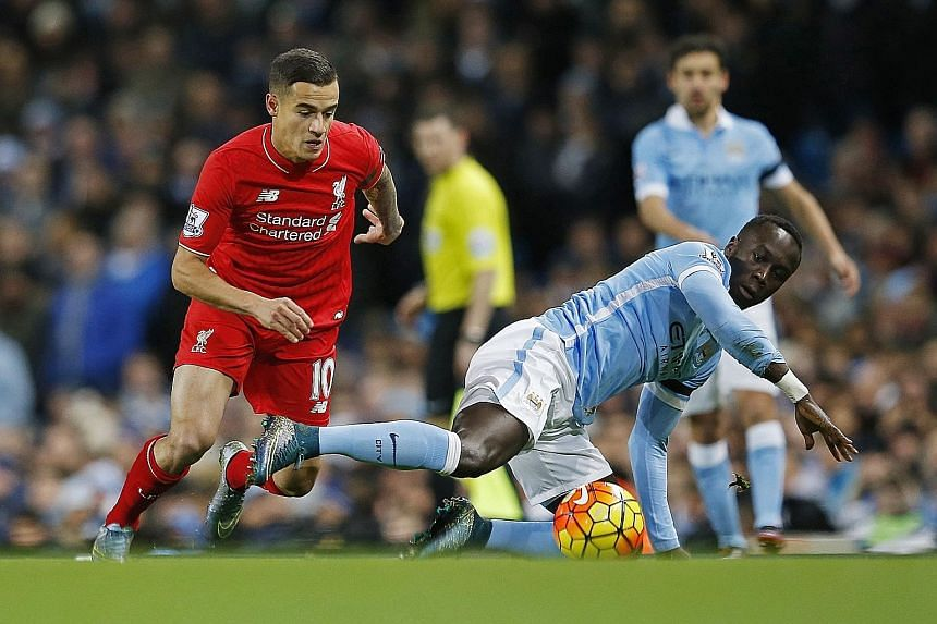 Manchester City's Bacary Sagna (front) slips as Philippe Coutinho of Liverpool is poised to pounce during their Premier League match on Saturday. Following the 4-1 thrashing at the hands of the Reds, Sagna said he was wrong in assuming he was ready t