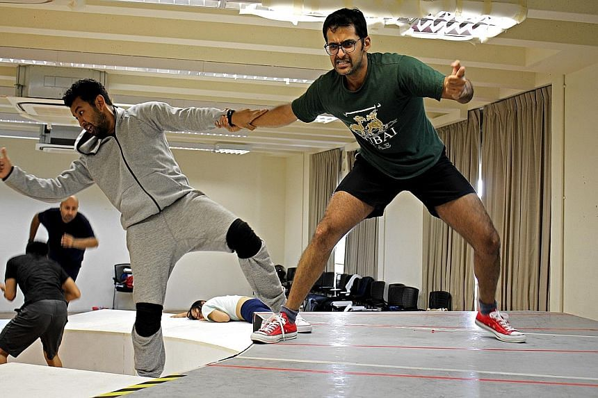 Pavan J. Singh (left) with cast member Ghafir Akbar during rehearsals.