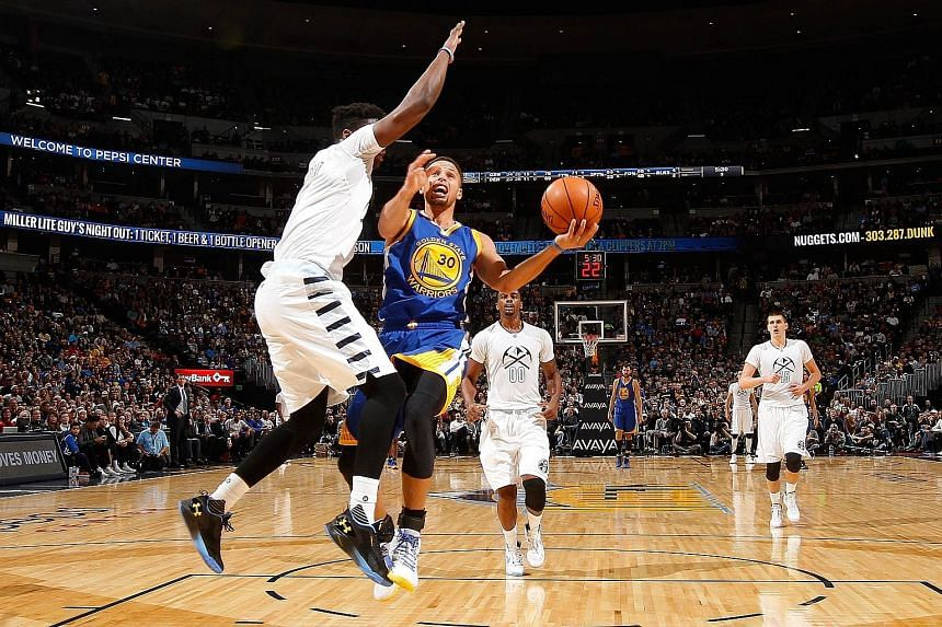 """Stephen Curry (No. 30) of Golden State shoots against Denver's Emmanuel Mudiay on Sunday. The winning streak, said Curry, is """"a real conversation"""" for his team."""