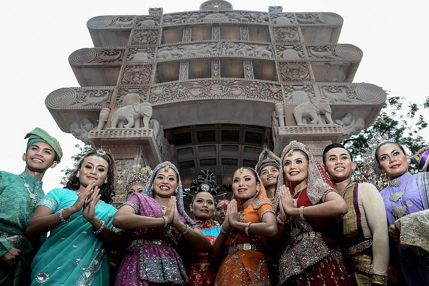 Models dressed in traditional attire in front of the Torana Gate in Kuala Lumpur's Brickfields district, during its inauguration by Malaysian Prime Minister Najib Razak and visiting Indian Prime Minister Narendra Modi yesterday. The gate, installed o