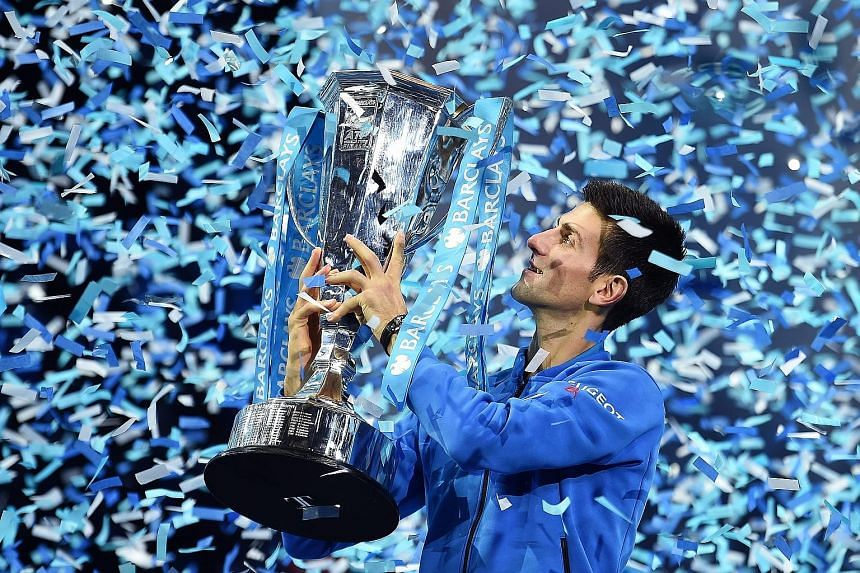 """Novak Djokovic lifting the ATP Tour Finals trophy in London, following his 6-3, 6-4 victory over Roger Federer. It was the Serb's 11th title of 2015 and he said: """"I'm just blessed and overwhelmed with the emotion and the thrill to be achieving such a"""