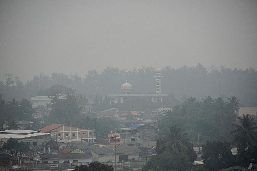 The smoky haze from forest fires in Indonesia this year spread as far as places like Narathiwat (above) in southern Thailand.