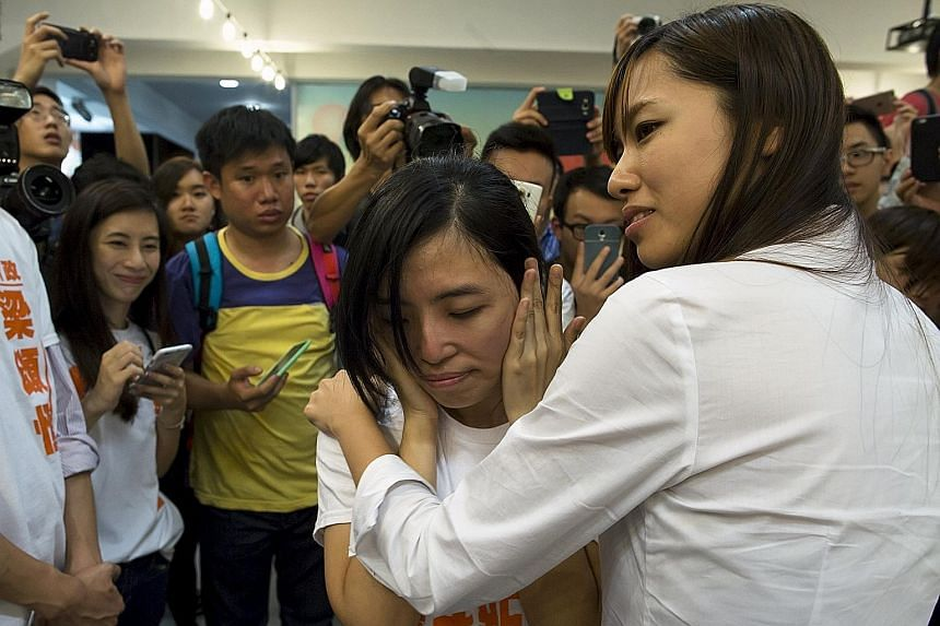 """Ms Kwong Po Yin, a member of Hong Kong's """"umbrella soldier"""" group Youngspiration, taking time to digest the news of her victory in Sunday's district council election."""