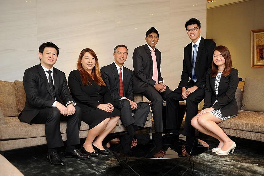 Citi country officer and head of Asean Michael Zink (with red tie) with some of Citi's local rising talents. From left: Retail banking head Charles Wong; treasury and trade solutions senior client experience manager Serena Liew; corporate and investm