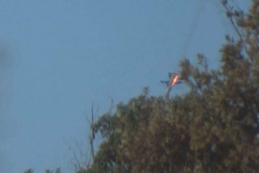 A war plane crashes in flames in a mountainous area in northern Syria after it was shot down by Turkish fighter jets near the Turkish-Syrian border on Nov 24, 2015.