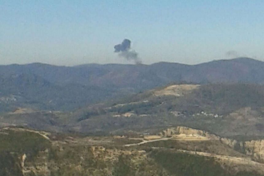 Some rises over a mountainous area in northern Syria after a war plane was shot down by Turkish fighter jets near the Turkish-Syrian border on Nov 24, 2015.
