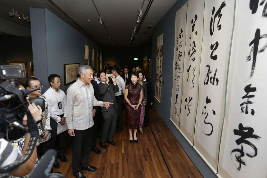 PM Lee (centre) touring the DBS Singapore Gallery during his visit to the National Gallery Singapore on Nov 23, 2015.