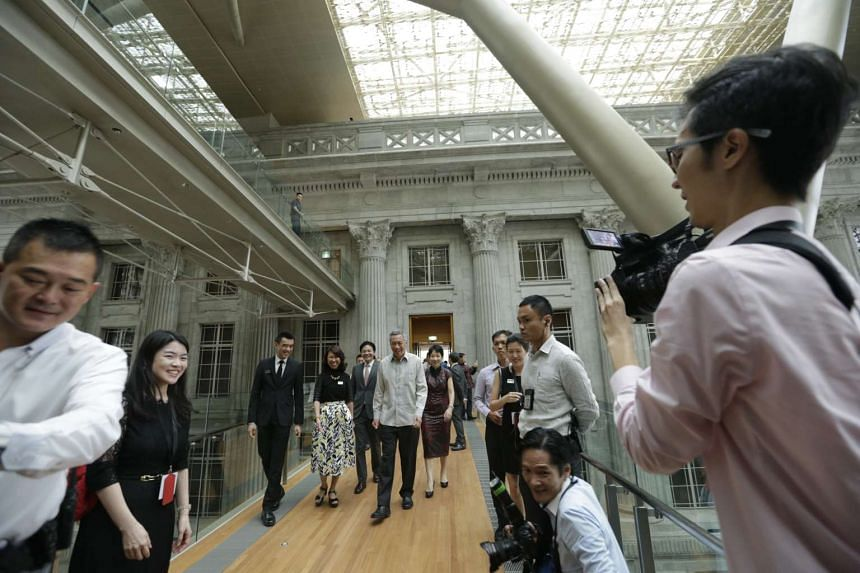 (Centre, from left) National Gallery Singapore director Eugene Tan, National Gallery Singapore chief executive Chong Siak Ching, National Development Minister Lawrence Wong, PM Lee Hsien Loong and Minister for Culture, Community and Youth Grace Fu cr