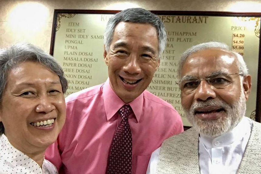 Ms Ho, PM Lee and Mr Modi taking a wefie in the restaurant.
