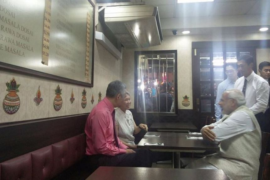 Mr Modi, Mr Lee and Ms Ho in conversation before dinner is served.