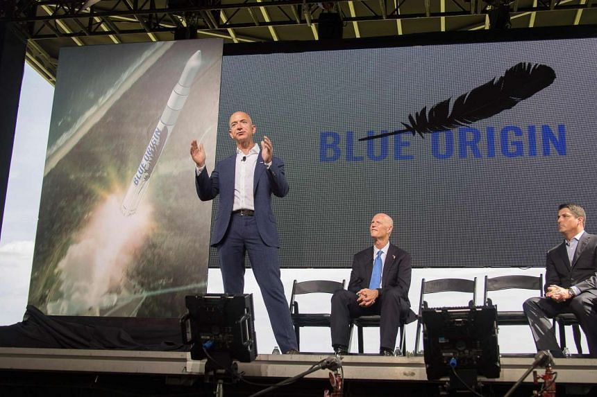 Jeff Bezos (Left) announces plans to build a rocket manufacturing plant and launch site at Cape Canaveral in September.