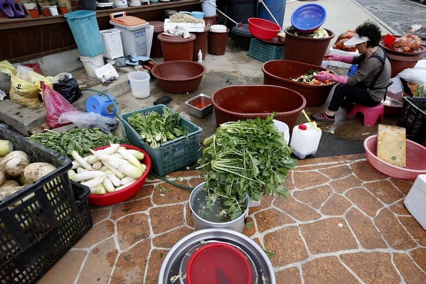 A resident prepares kimchi for the winter on Yeonpyeong Island in South Korea on Monday.