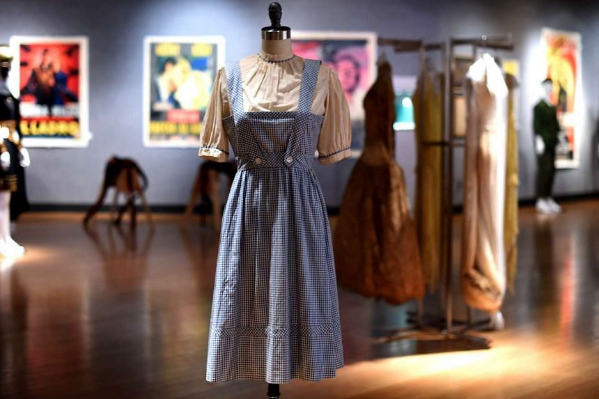 """A Judy Garland-worn """"Dorothy"""" dress from The Wizard of Oz that sold at auction on Monday."""