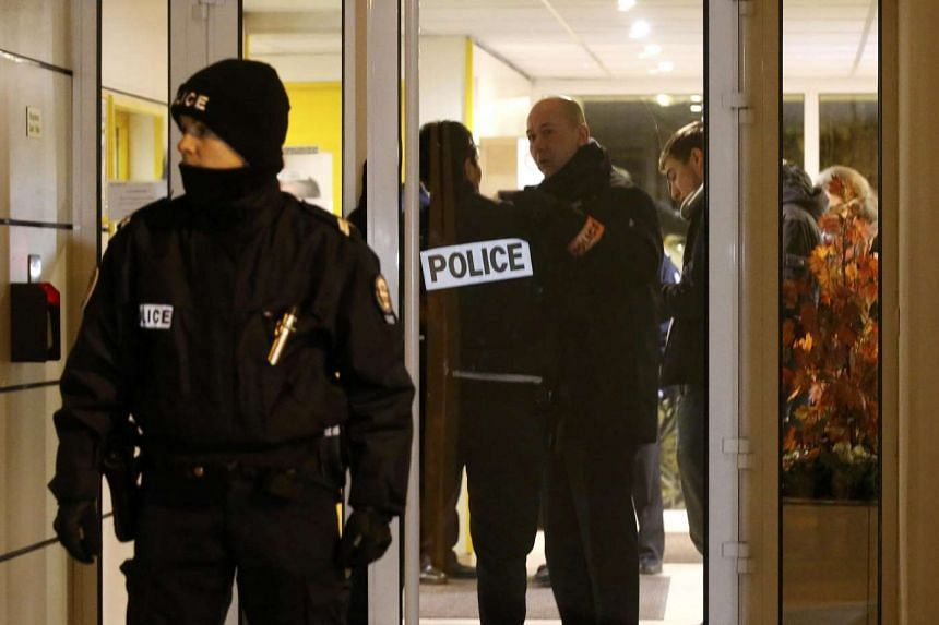 French police cordon the area after an alleged explosive belt was found in Montrouge on Monday.