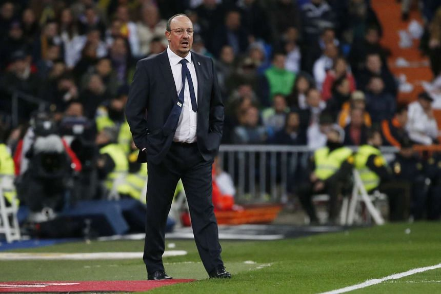 Real Madrid manager Rafael Benitez paces on the sidelines.