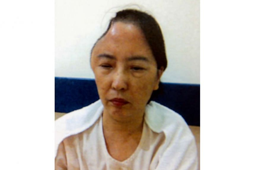 Madam Ding Weibo hit her head on a seat in an SMRT bus and went into a coma in 2011.