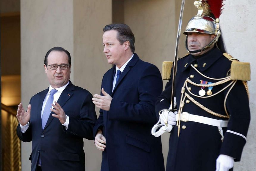 French President Francois Hollande (left) with British Prime Minister David Cameron after a meeting at Paris' Elysee Palace yesterday. Mr Cameron said he will make a case to the British Parliament about joining air strikes in Syria.