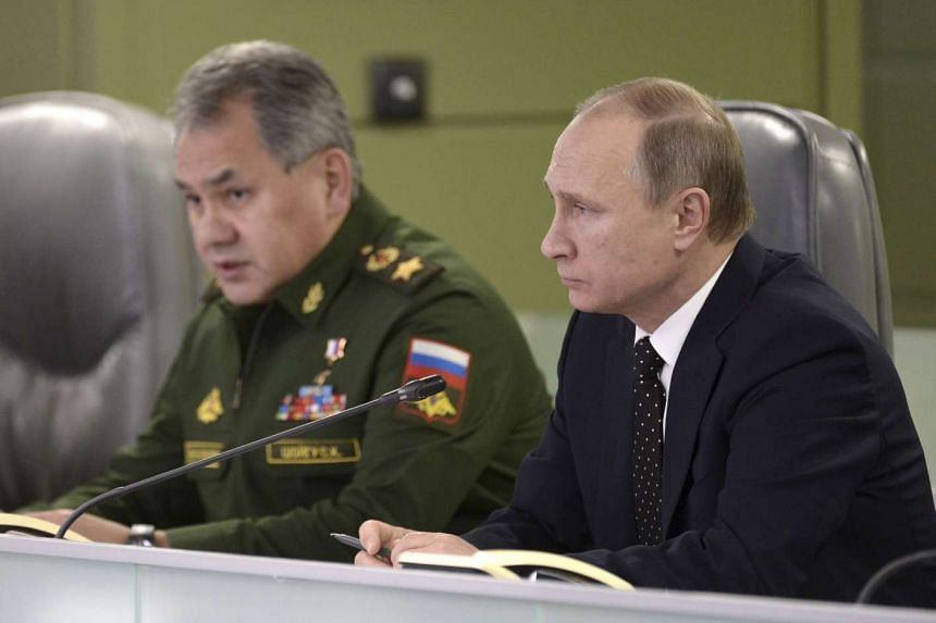 Russian Defence Minister Sergei Shoigu (right) said that Russia is sending its most hi-tech air defence system to Syria.