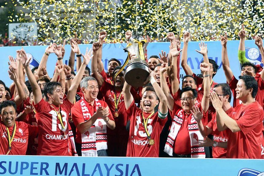 The LionsXII, with PM Lee Hsien Loong, celebrating winning the Malaysian Super League in 2013.