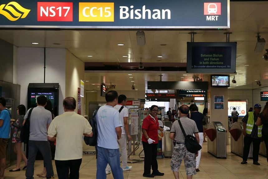 SMRT staff directing commuters at Bishan MRT station during the breakdown.