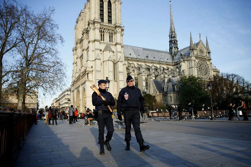 French Police patrol in front of Notre Dame Cathedral in Paris, France.