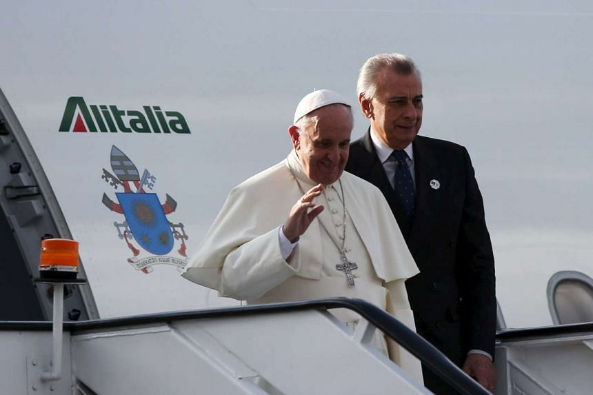 Pope Francis waves upon arrival for his first papal visit to the African Continent.