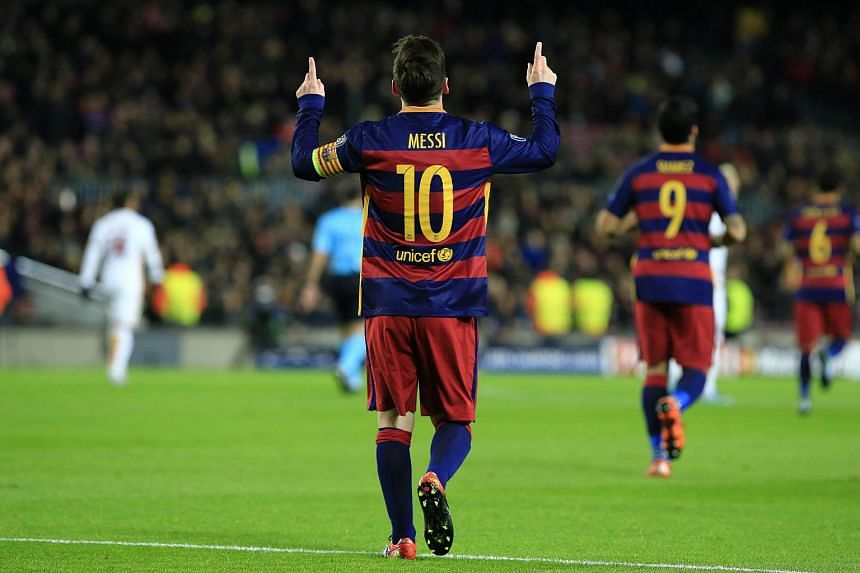 Barcelona's Lionel Messi celebrates after scoring during the Uefa Champions League Group E football match between Roma.