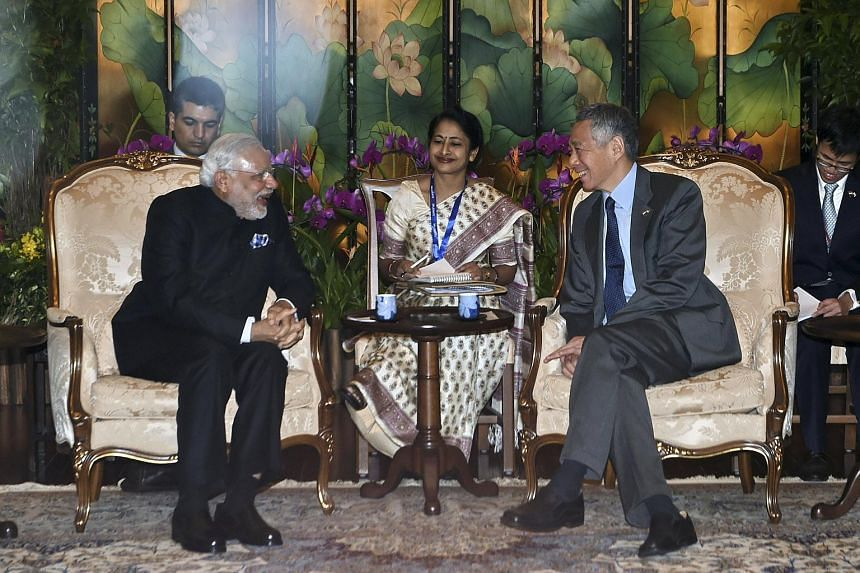 India's Prime Minister Narendra Modi (left) meets with Singapore's Prime Minister Lee Hsien Loong (right) at the Istana in Singapore Nov 24, 2015.