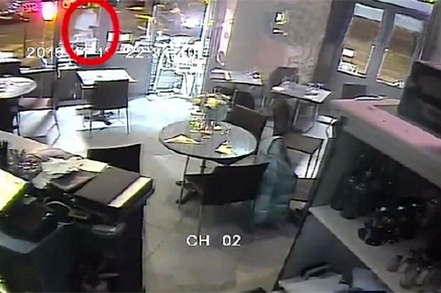 A screengrab from the video footage of the Paris restaurant as it was attacked by gunmen on Nov 13.