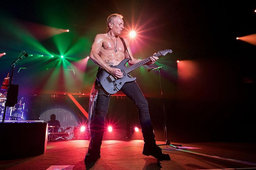 Def Leppard's guitarist Phil Collen performing at Suntec Singapore Convention & Exhibition Centre, on Nov 24, 2015.