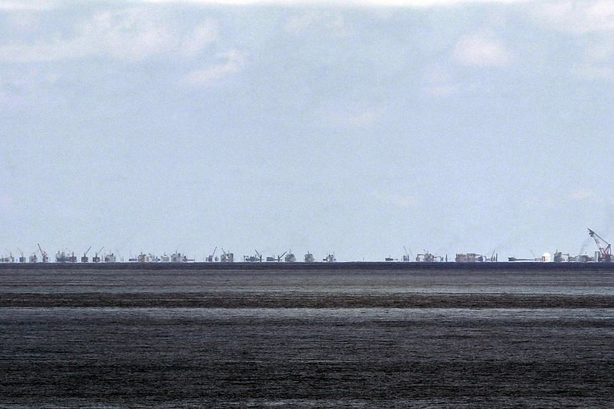 The alleged on-going land reclamation of China at the Subi reef is seen from Pagasa island in the South China Sea.